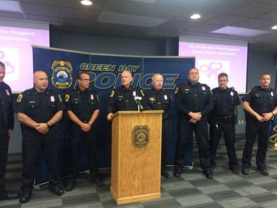 Green Bay officers swap gold badges for pink